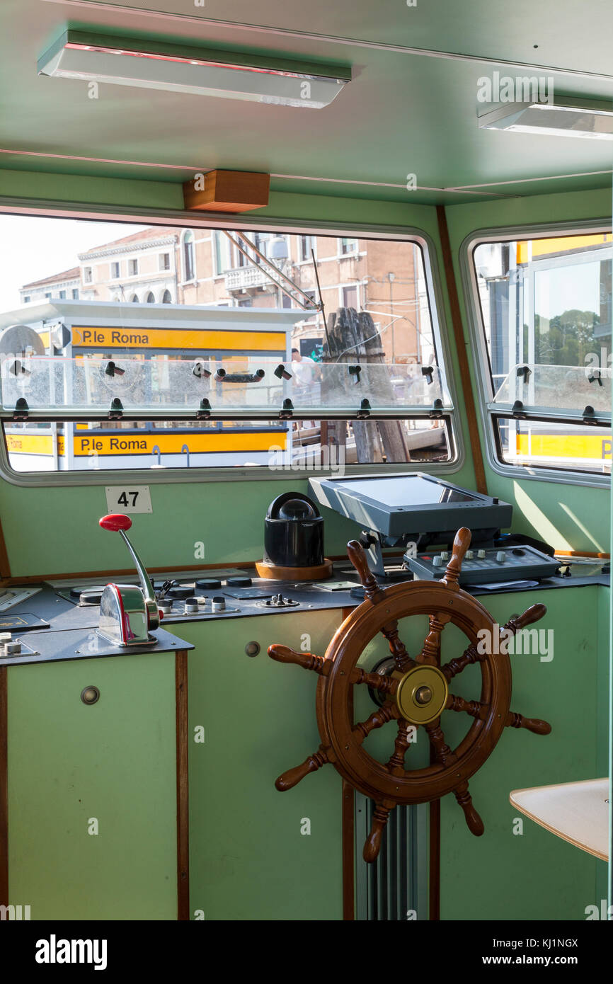 Interior of the captains cabin on a vaporetto waterbus in Venice, Italy as it is docked at the Piazzale Roma stop. - Stock Image