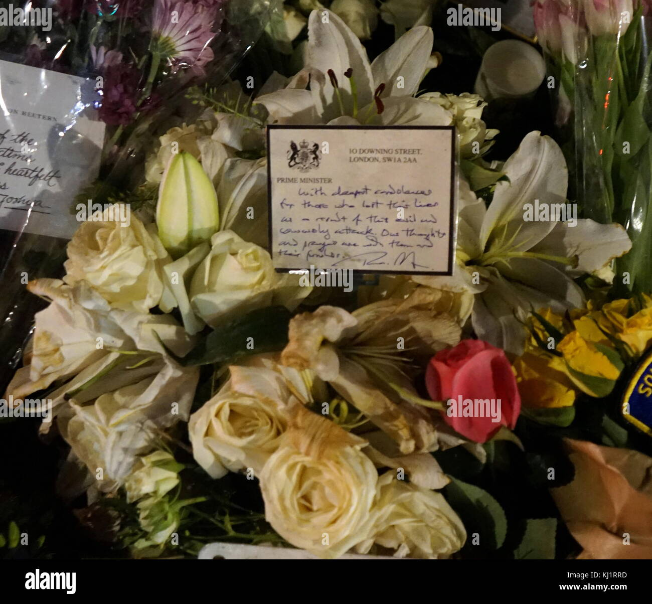 Flowers and tribute from British Prime Minister Theresa May, for the murdered Police officer, PC Keith Palmer, at Stock Photo