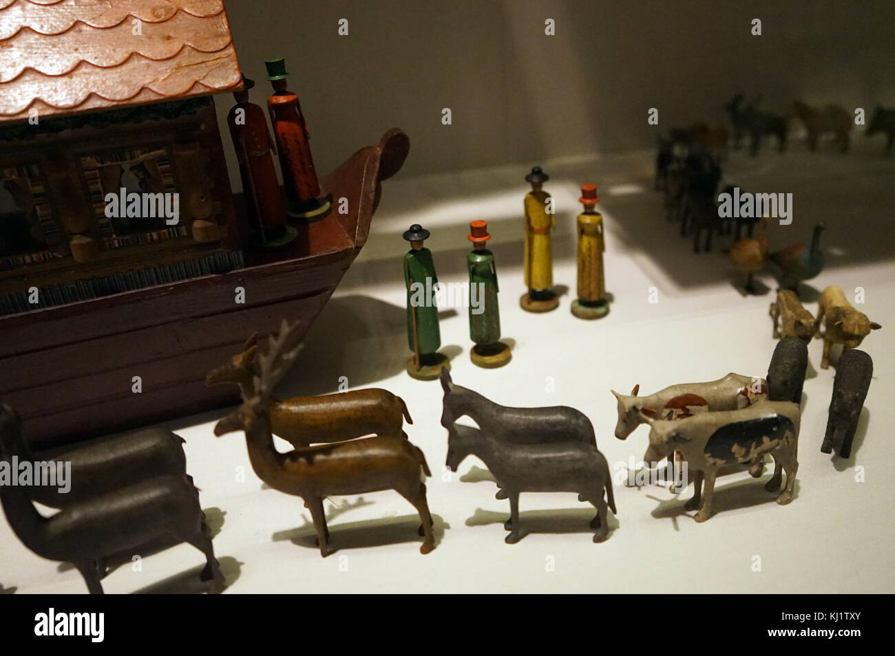Wooden figurines used to recreate the story of Noah's Ark. The animals are shown here in pairs ready to board - Stock Image