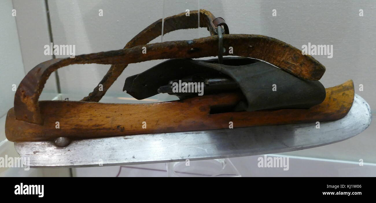A Victorian era ice skate, made with a wooden base and a fixed steel blade. Dated 19th Century - Stock Image