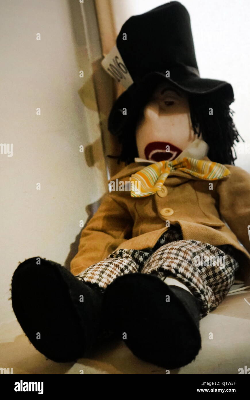 Stuffed 'Mad Hatter' doll. The Mad Hatter is a character from the novel 'Alice's Adventures in Wonderland' - Stock Image