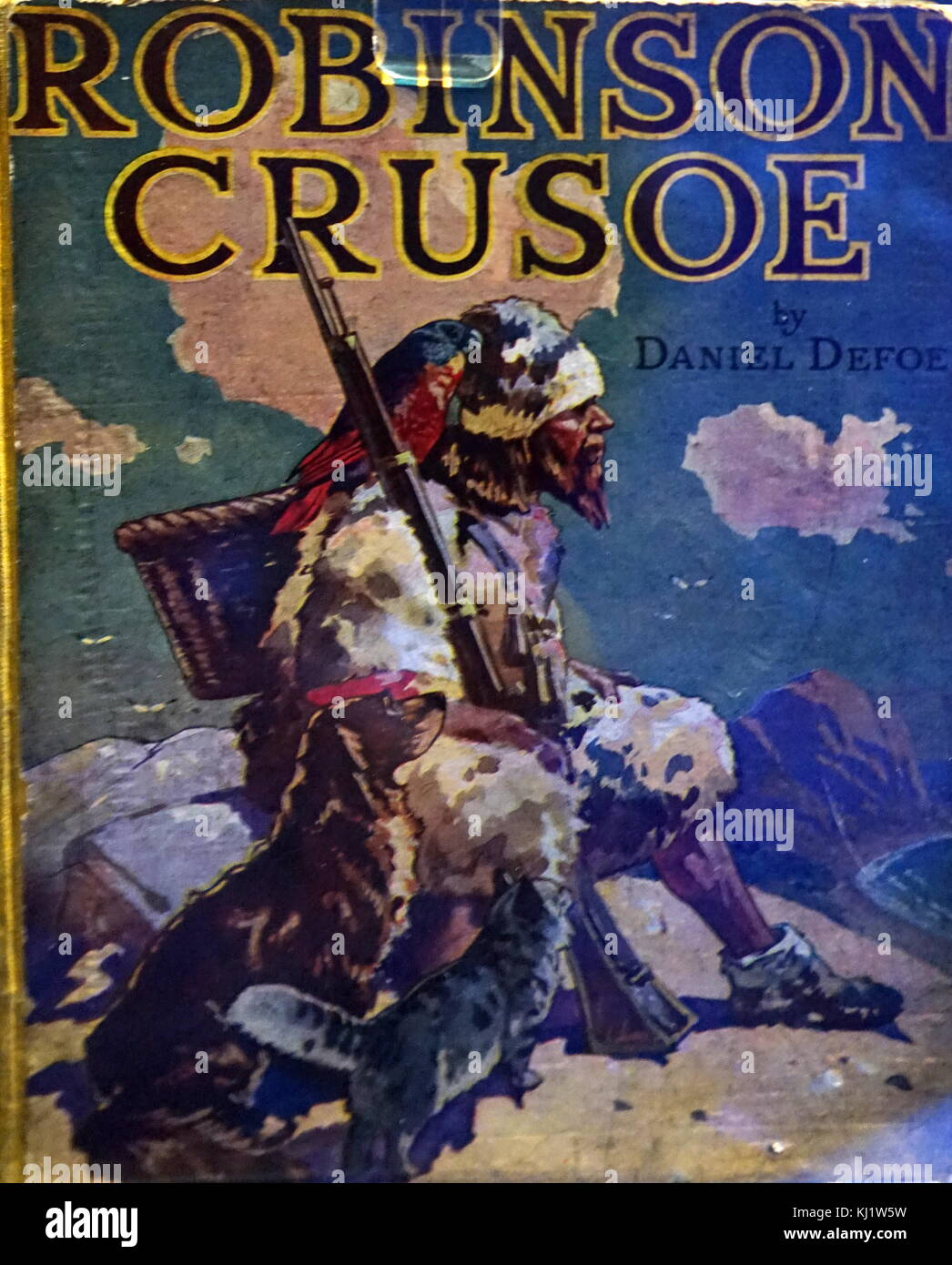 Front cover of Robinson Crusoe by Daniel Defoe (1660-1731) an English trader, writer, journalist and spy. Dated - Stock Image