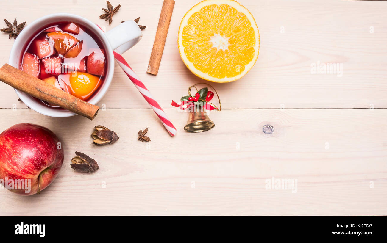 New Year's and Christmas decoration with ingredients for preparation mulled wine, cinnamon and cloves, lined - Stock Image