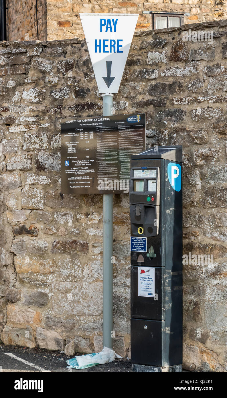 Durham County Council car park ticket payment machine with Pay Here sign and board displaying conditions, charges - Stock Image