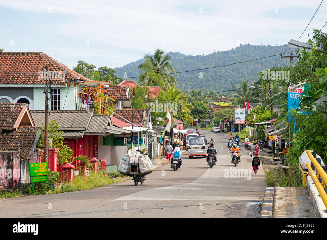 Street scene showing motorbikes in the coastal town Carita, Pandeglang Regency, Banten Province, West Java, Indonesia - Stock Image