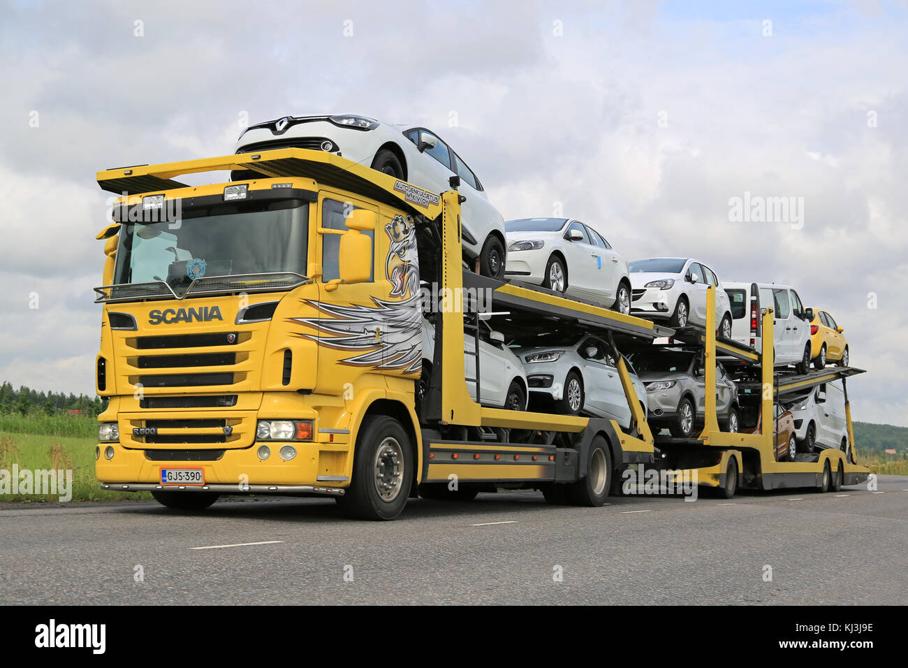 SALO, FINLAND - JULY 26, 2015: Scania R500 car carrier hauls new cars along road. A scrapping scheme for old vehicles Stock Photo