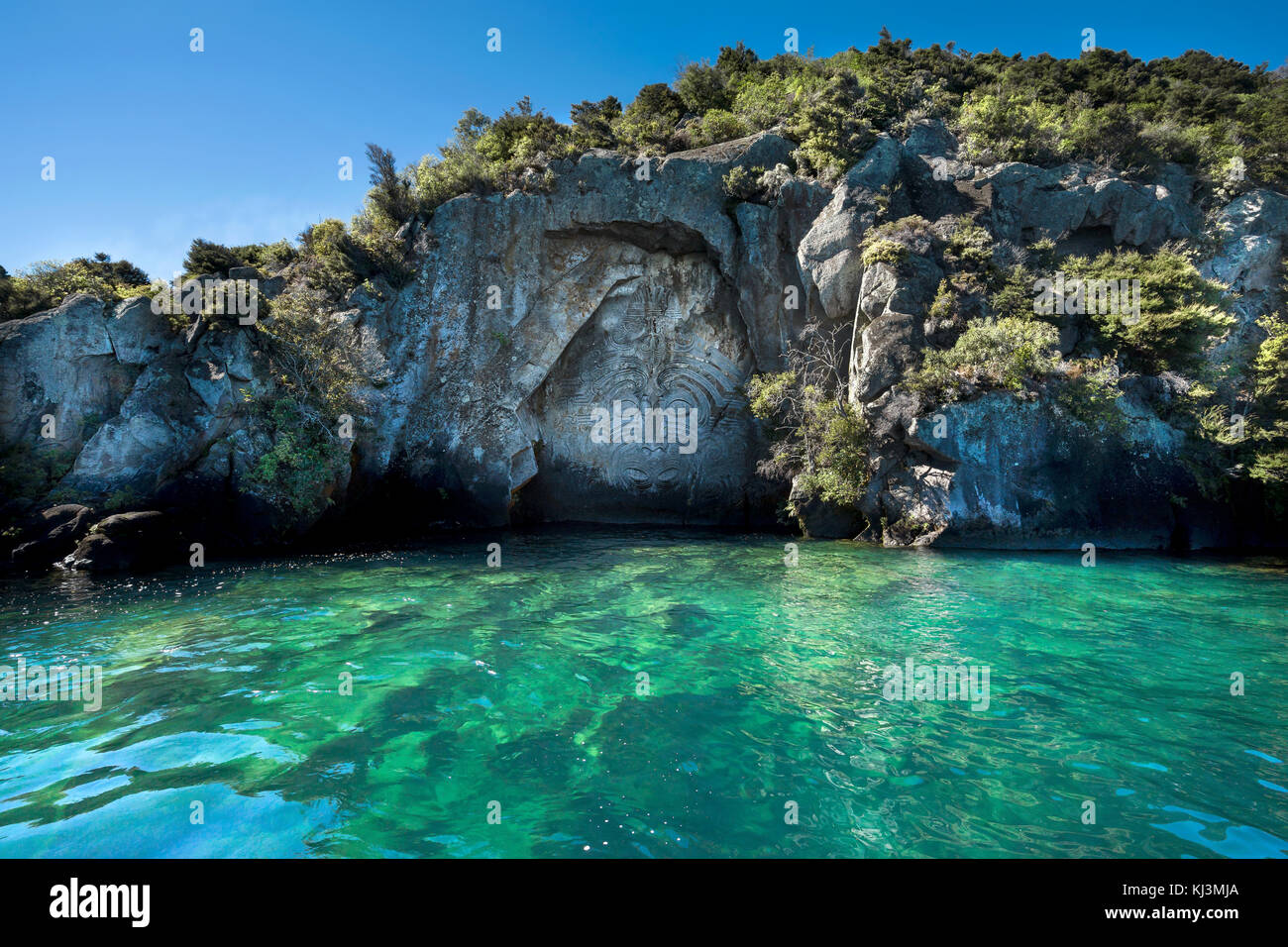 Maori rock carvings on lake taupo new zealand stock photo