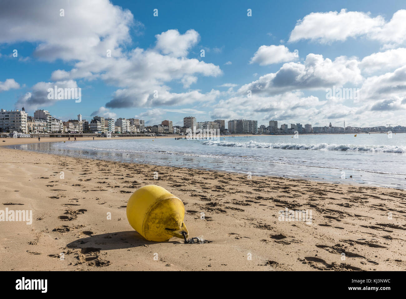 Les Sables d'Olonne beach at low tide with a yellow buoy (Vendee, France) Stock Photo