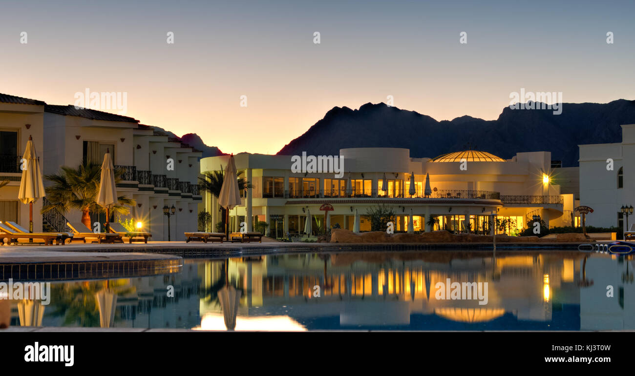 Nuweiba Beach Resort at sunset with the mountains in the background of Sinai, Egypt. - Stock Image
