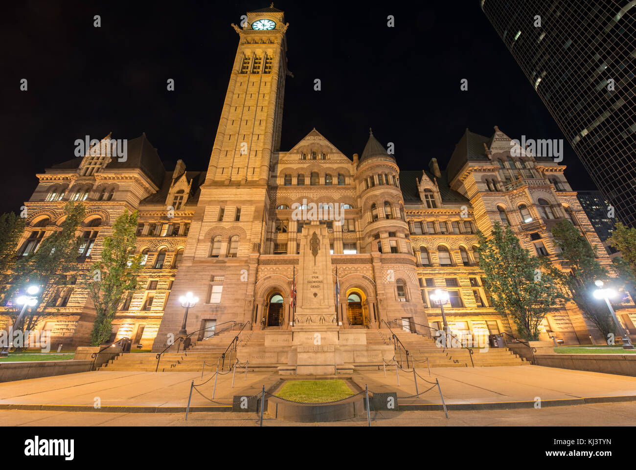 Toronto's Old City Hall at night. One of the largest buildings in Toronto and the largest civic building in North America upon completion in 1899. Stock Photo