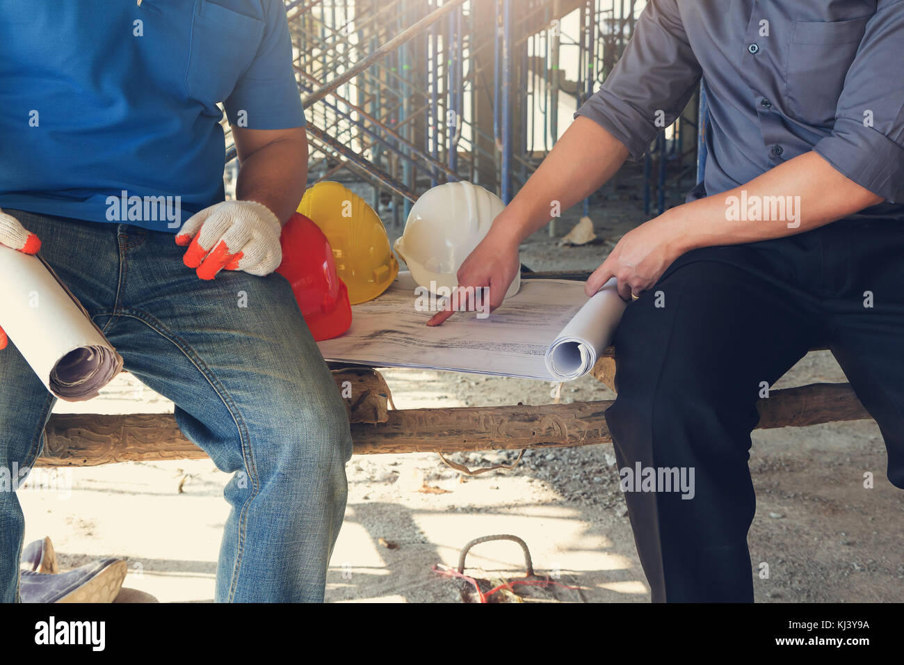 Construction concepts, Engineer and Architect working at Construction Site with blueprint, Vintage Effect - Stock Image