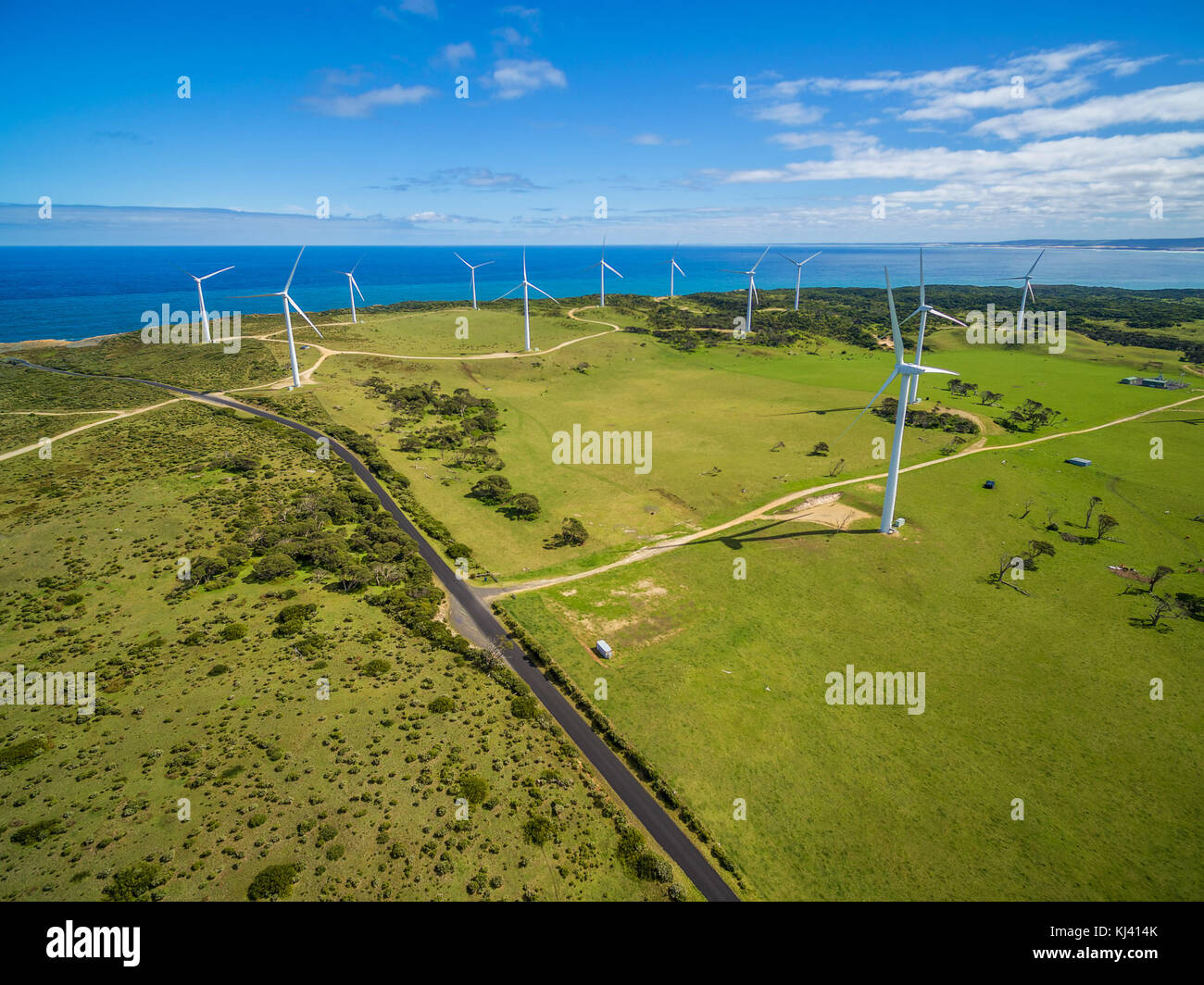 Aerial view of rural road and wind farm in Australia - Stock Image