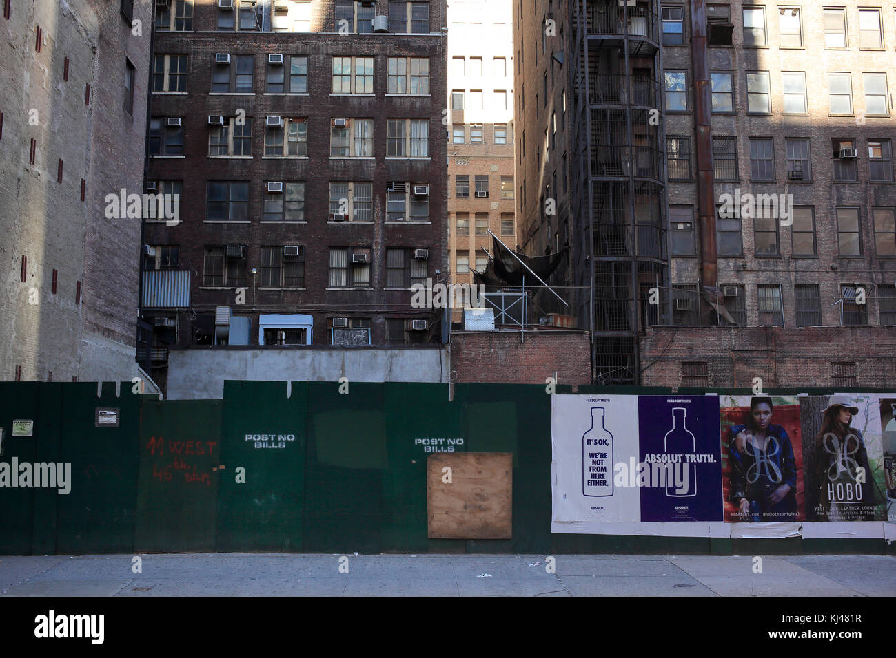 advertising on boarded up construction site in midtown Manhattan, New York City Stock Photo