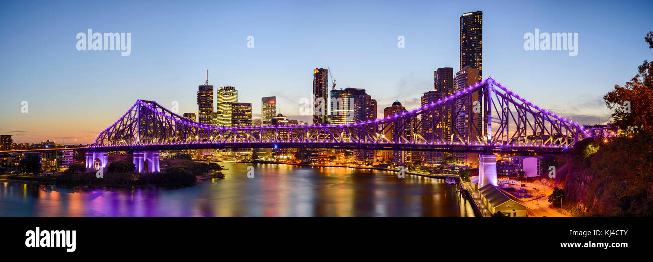 Panorama of the Story Bridge and Brisbane City from Wilsons Outlook Reserve after sunset in Brisbane, Queensland, - Stock Image