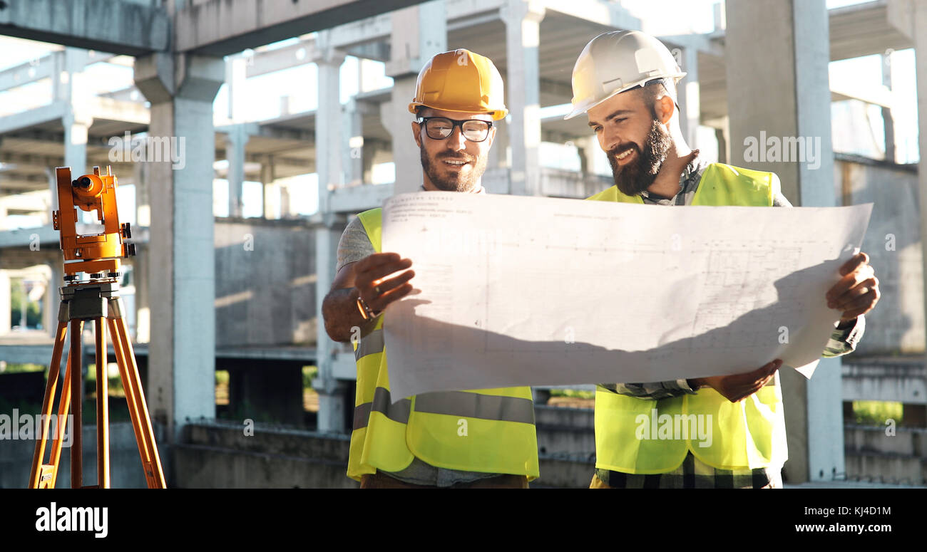 Team of architects people in group on construciton site - Stock Image