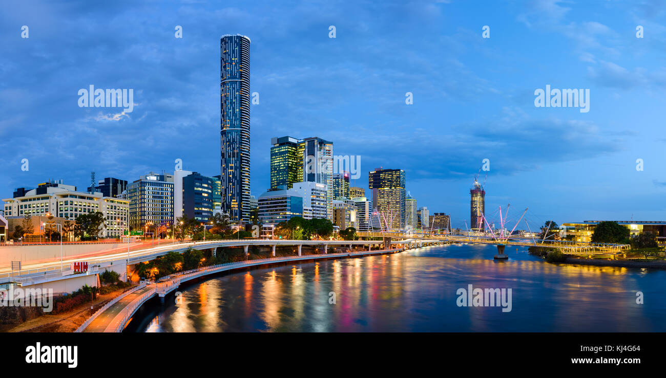 Panorama of the Brisbane City, river and Kurilpa Bridge after sunset, Brisbane, Queensland, Australia - Stock Image
