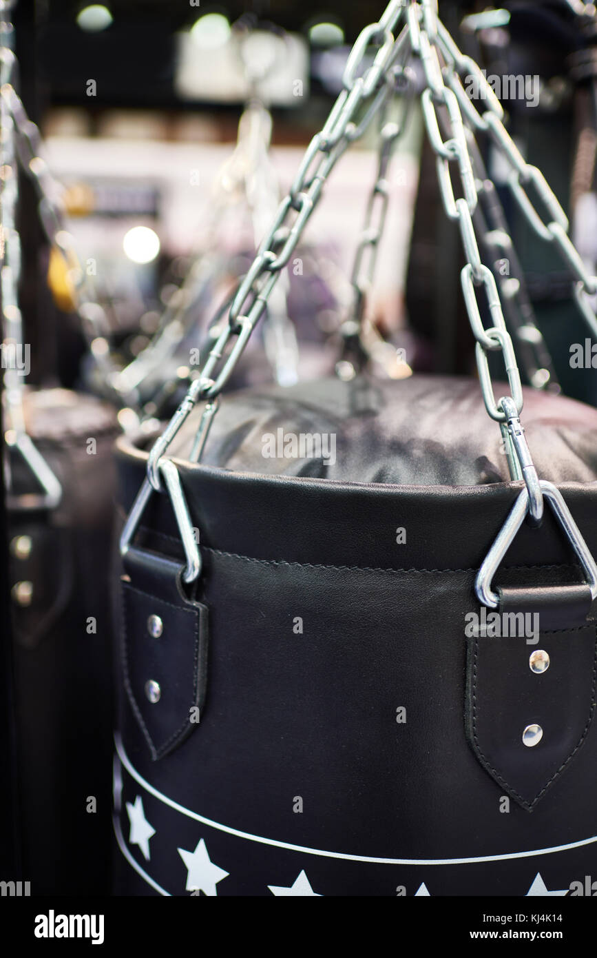 Black leather Punching bag on chains - Stock Image