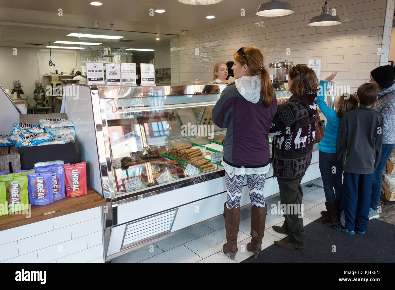 People shopping for vegan meats at The Herbivorous Butcher shop in Minneapolis, Minnesota, USA. - Stock Image
