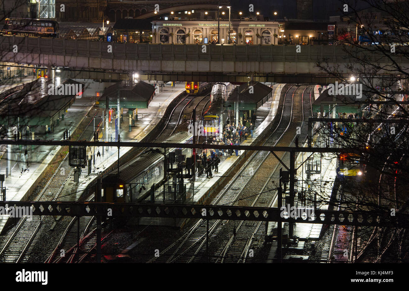 Passengers wait on the platform at  Waverley Station, Edinburgh - Stock Image