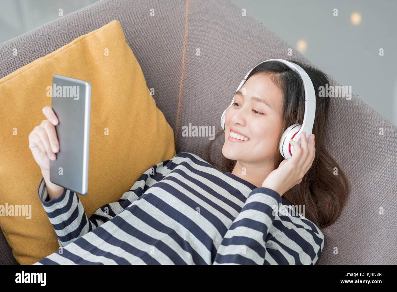 Asian Teenager Girl Wear Headphone Listening Music Play With