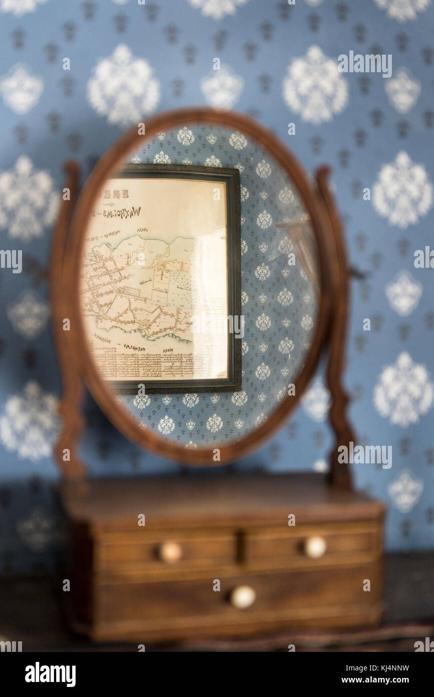 Old fashioned small beauty mirror with a map reflected in it, Vaxholm, Stockholm archipelago, Sweden - Stock Image