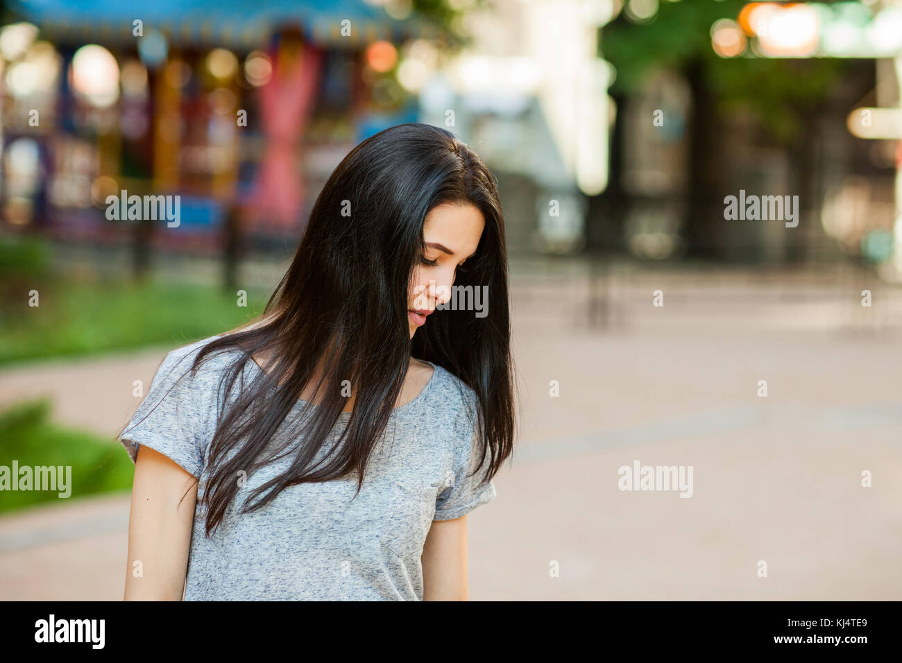 thoughtfull female in the street - Stock Image