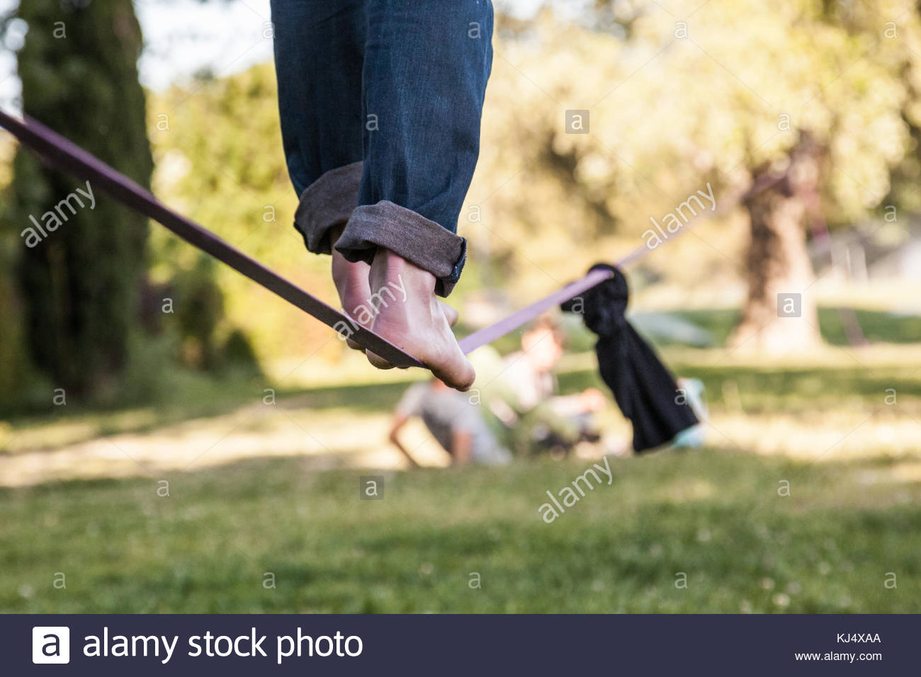 man's feet on low tight rope Stock Photo