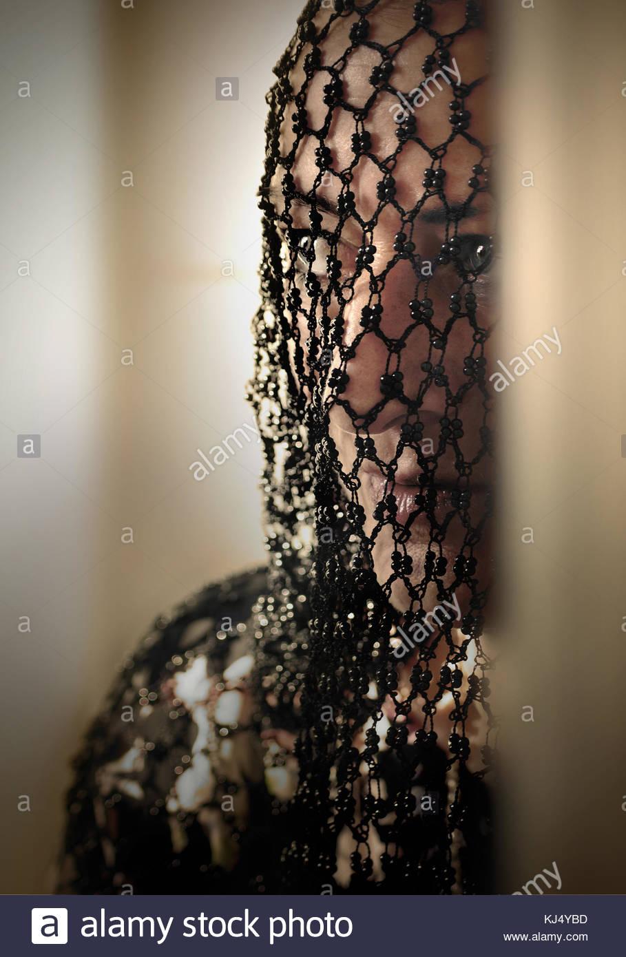 Veiled woman portrait - Stock Image