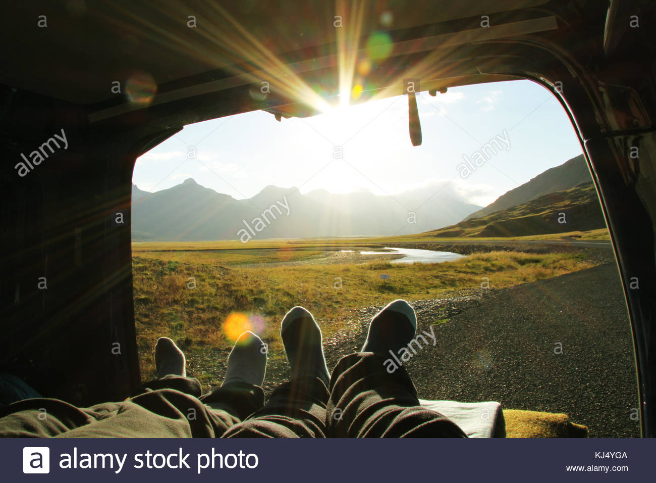 couple's feet in tent - Stock Image