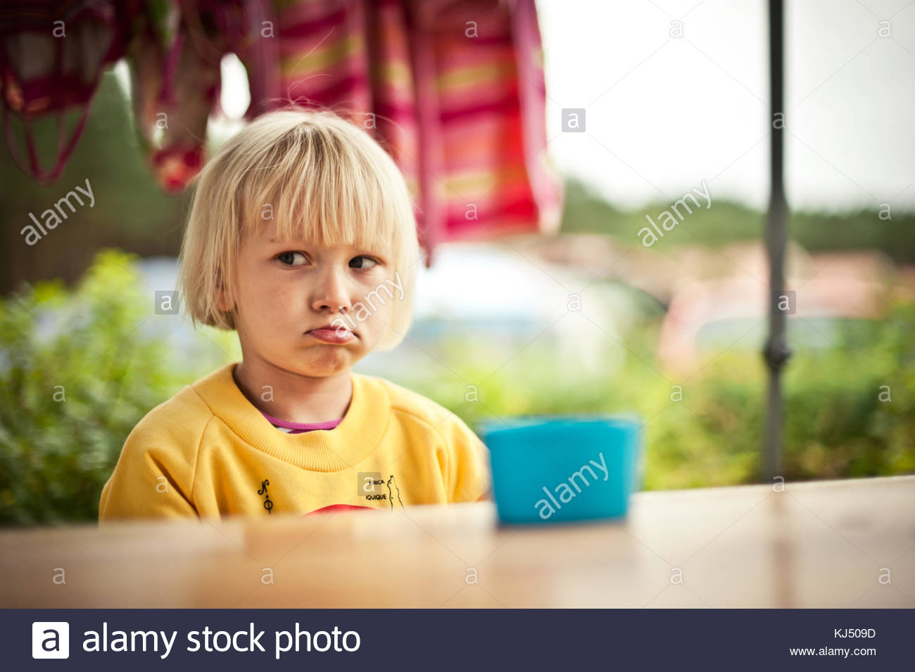 sulky blonde boy - Stock Image