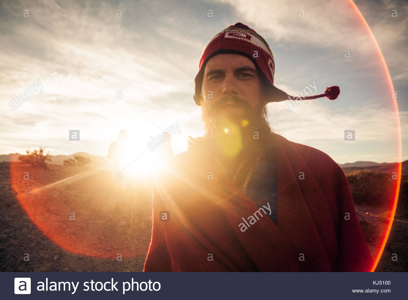 Traveler with woolen cap with flaps ear in the sunlight close-up - Stock Image