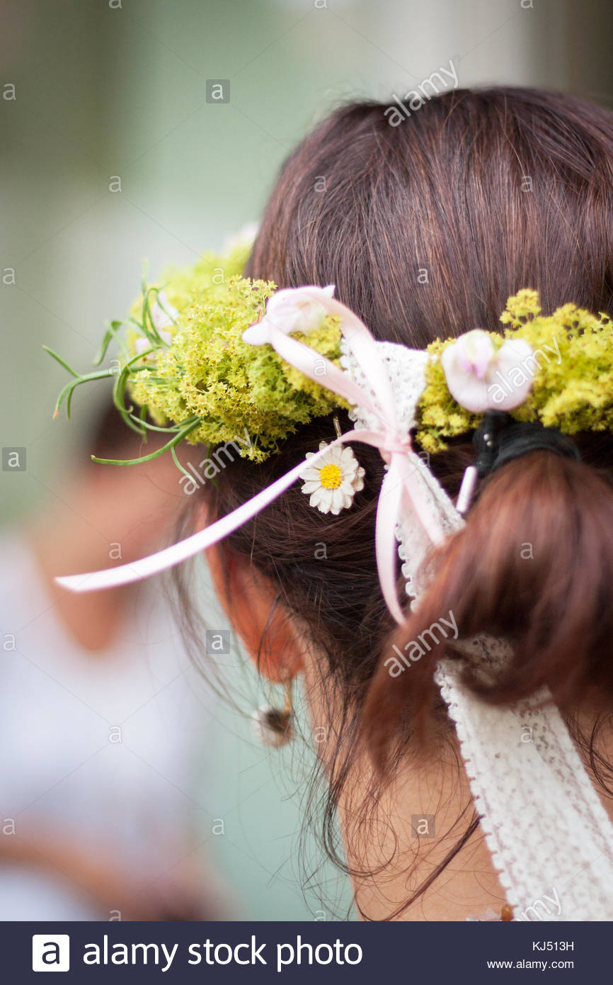 Woman with flower wreath - Stock Image