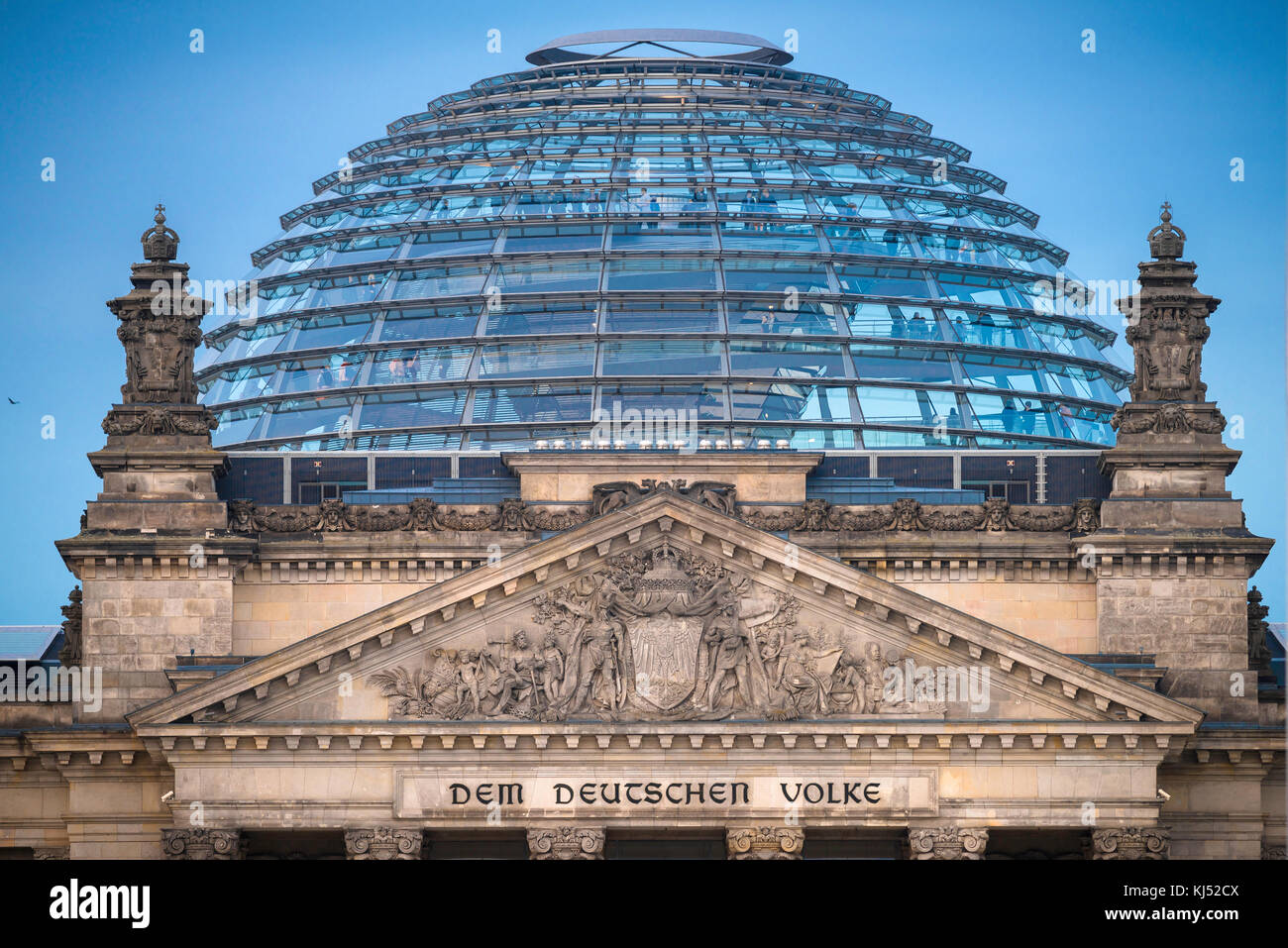 Berlin Reichstag, close-up view of the pediment and glass dome of the Reichstag building in Berlin, Germany. - Stock Image