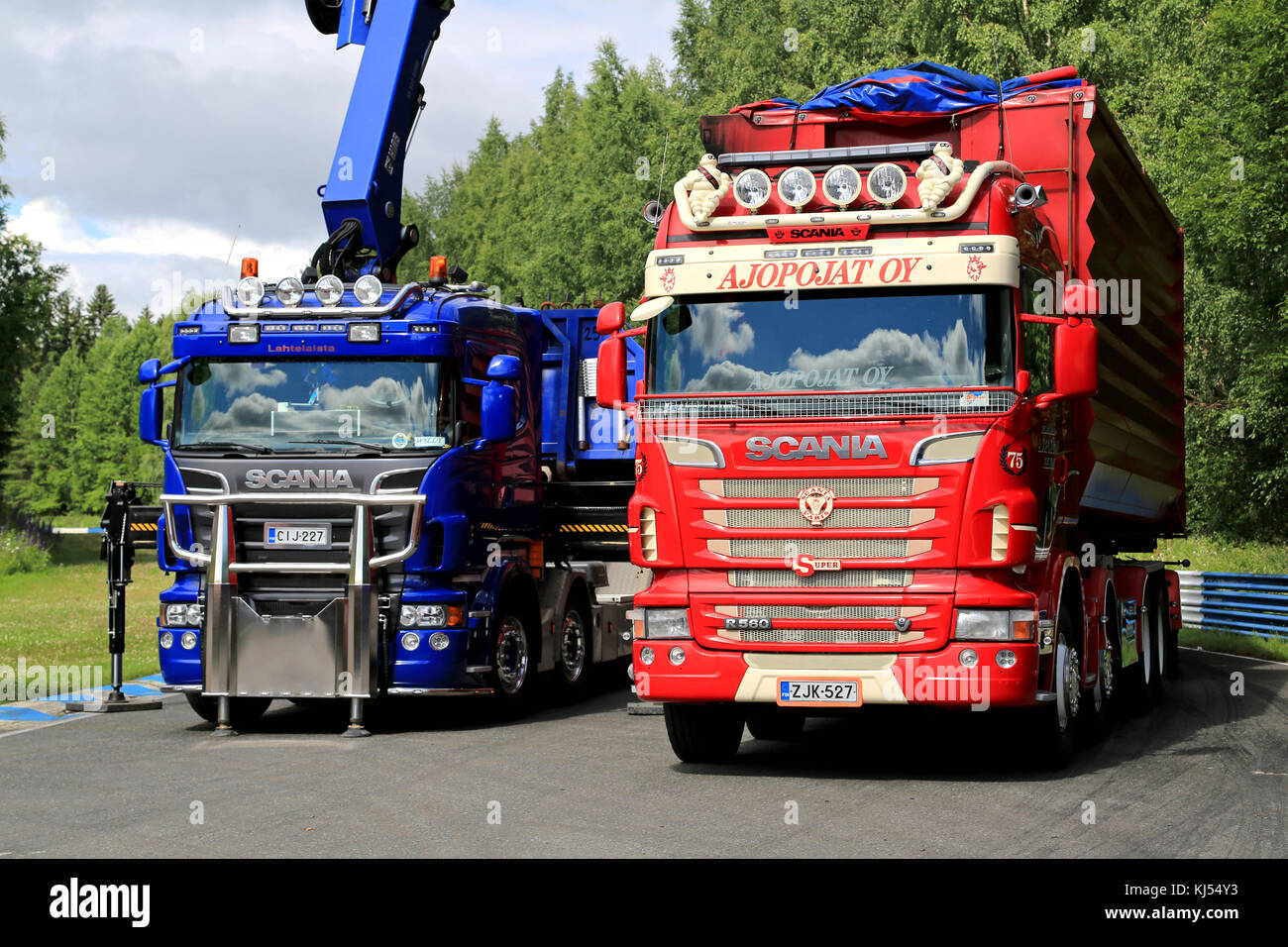 HAMEENLINNA, FINLAND - JULY 11, 2015: Red R560 and blue Scania trucks at Tawastia Truck Weekend 2015. Stock Photo
