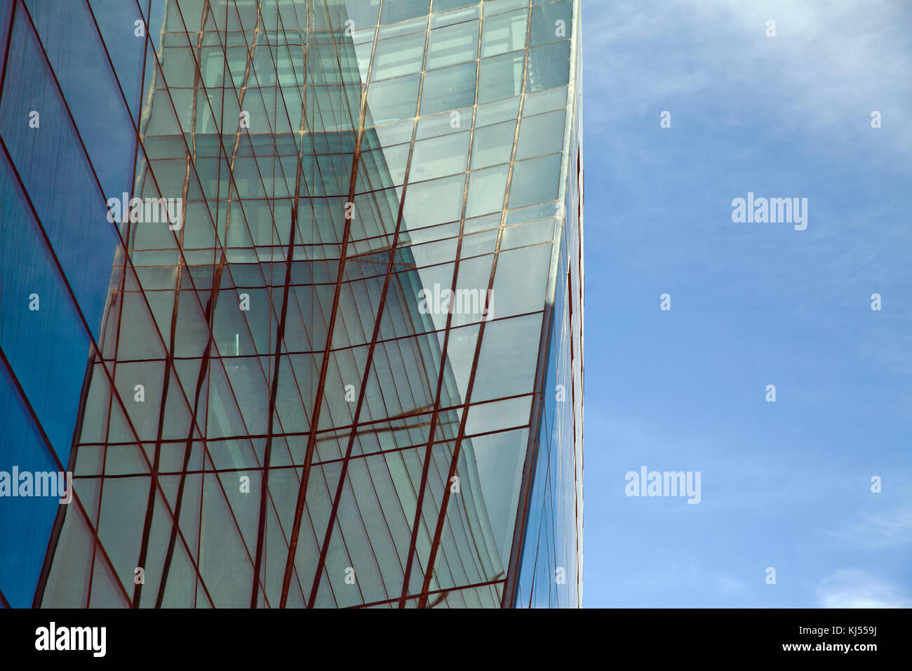 Modern glass silhouettes on modern building building glass window