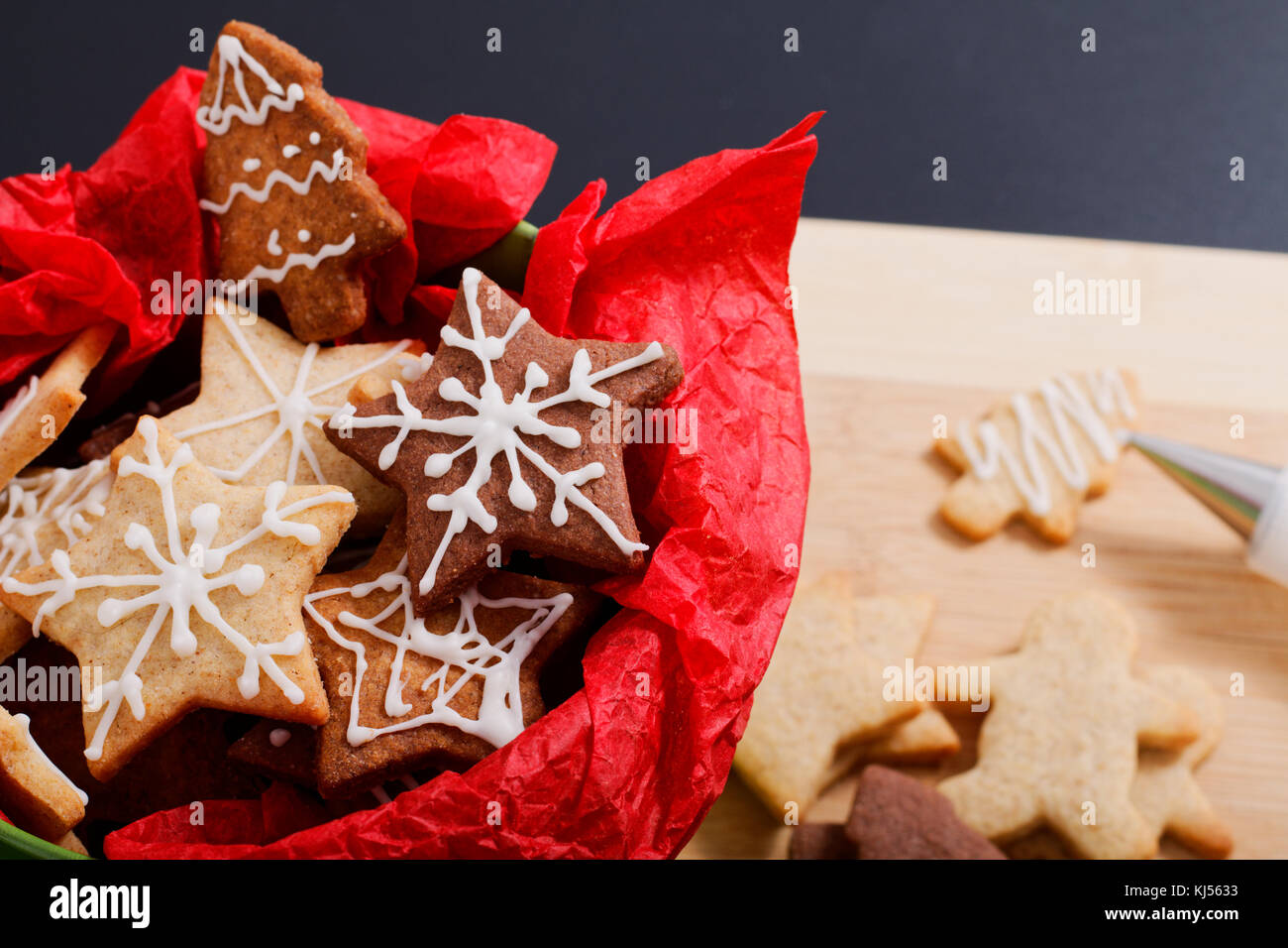 Idea DIY Do it yourself new year and Christmas gift concept butter sugar cookies with royal icing decoration in - Stock Image