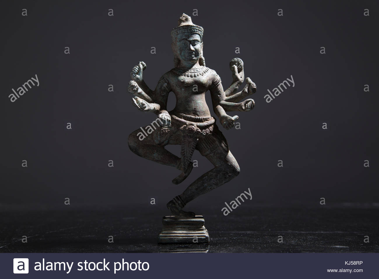 Religious Statue with 8 arms - Stock Image