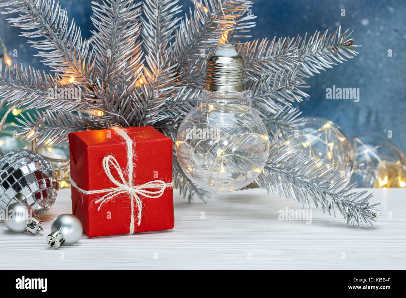 Silver Christmas Tree Branch With Old Retro Garlands Decorations