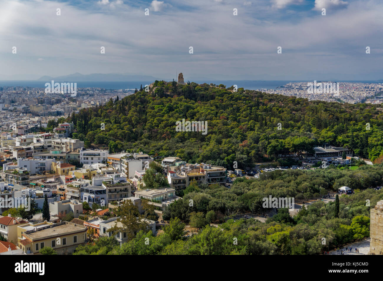 Athens, Greece Philopappos Monument day view and cityscape. Panoramic view from the Acropolis of Athens of Tomb - Stock Image