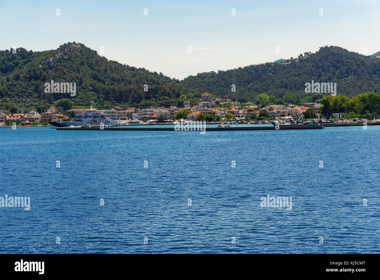 Thasos Island, Greece. Limenas town panorama day view. Landscape of capital town Limenas with moored car ferries Stock Photo