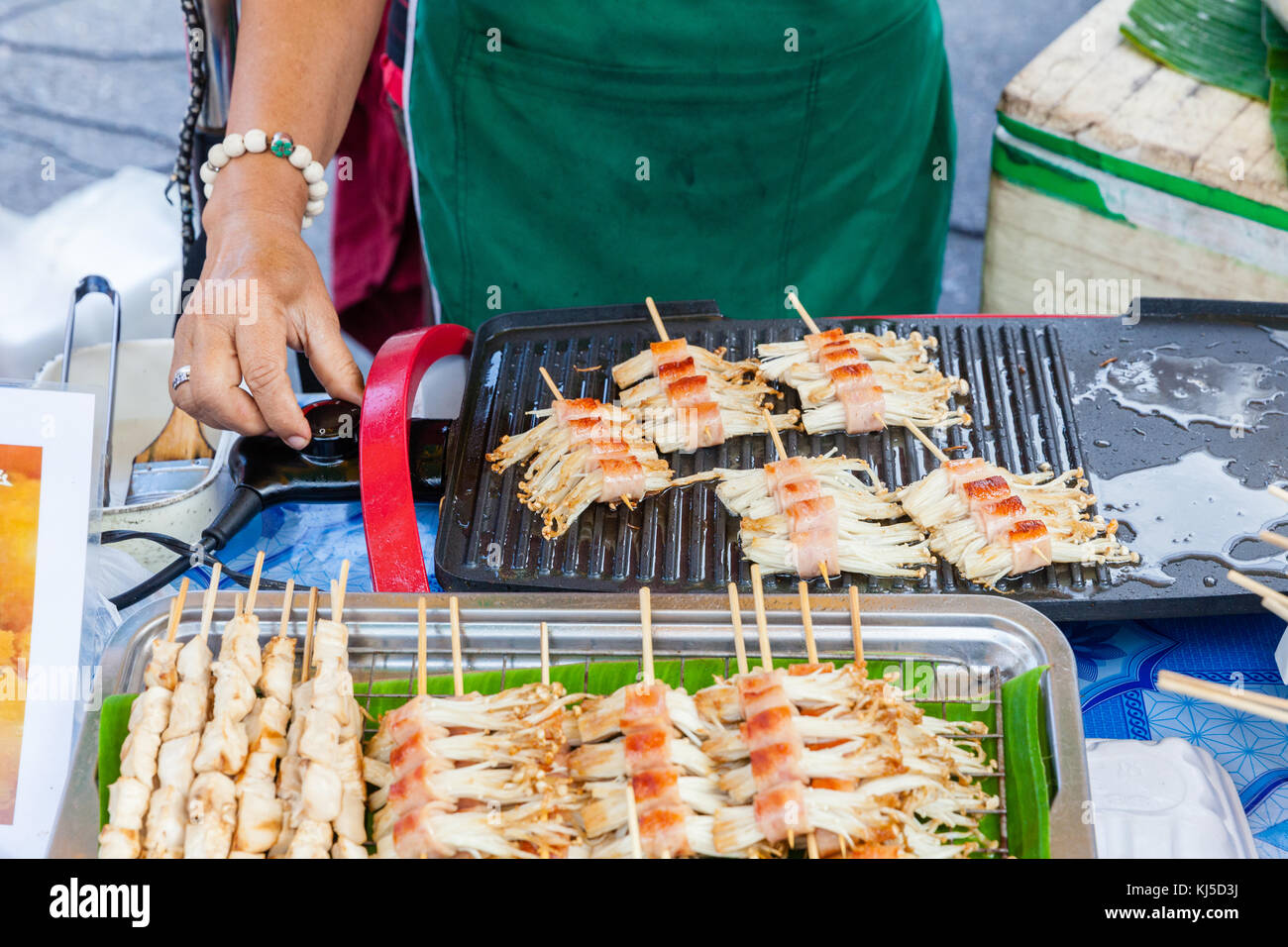 CHIANG MAI, THAILAND - AUGUST 21: Food vendor cooks at the Sunday Market (Walking Street) on August 21, 2016 in Stock Photo