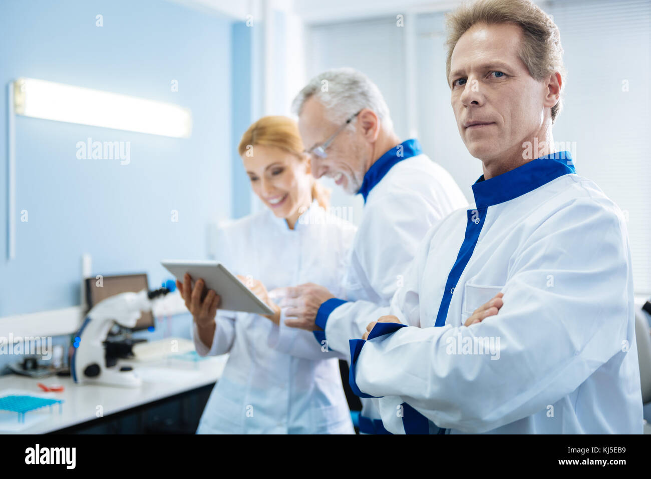 Happy people of science working in the lab - Stock Image