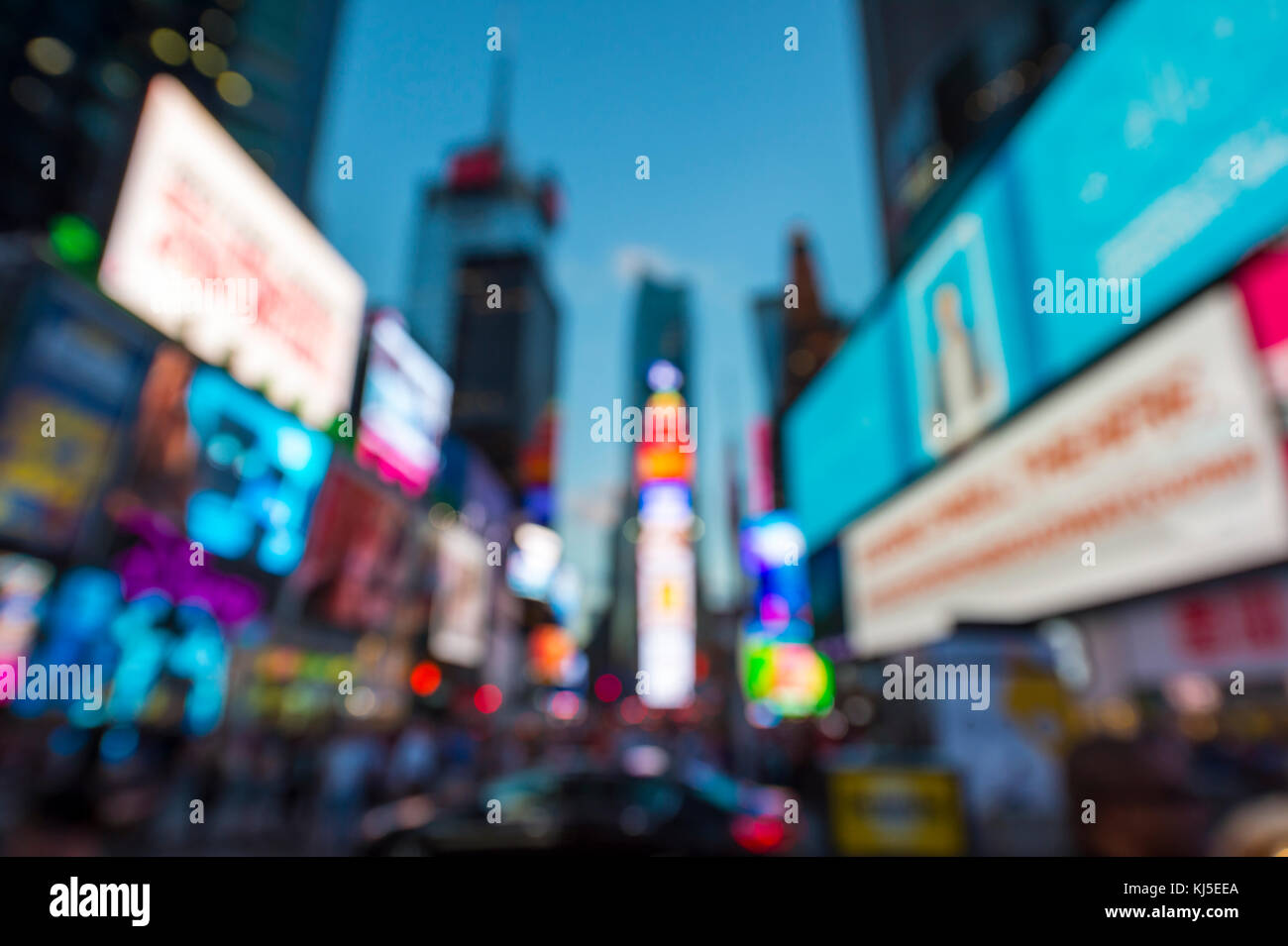 Defocused view of Times Square signage, taxi traffic, and holiday crowds in the lead-up to New Year's Eve in - Stock Image