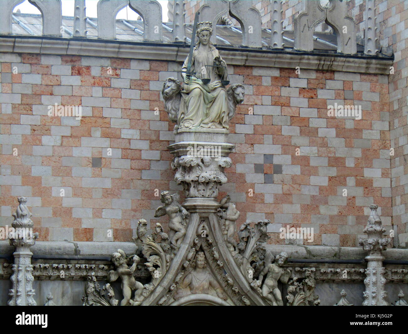 Detail from the façade of the Doge's Palace (Palazzo Ducal) built in Venetian Gothic style, and one of - Stock Image