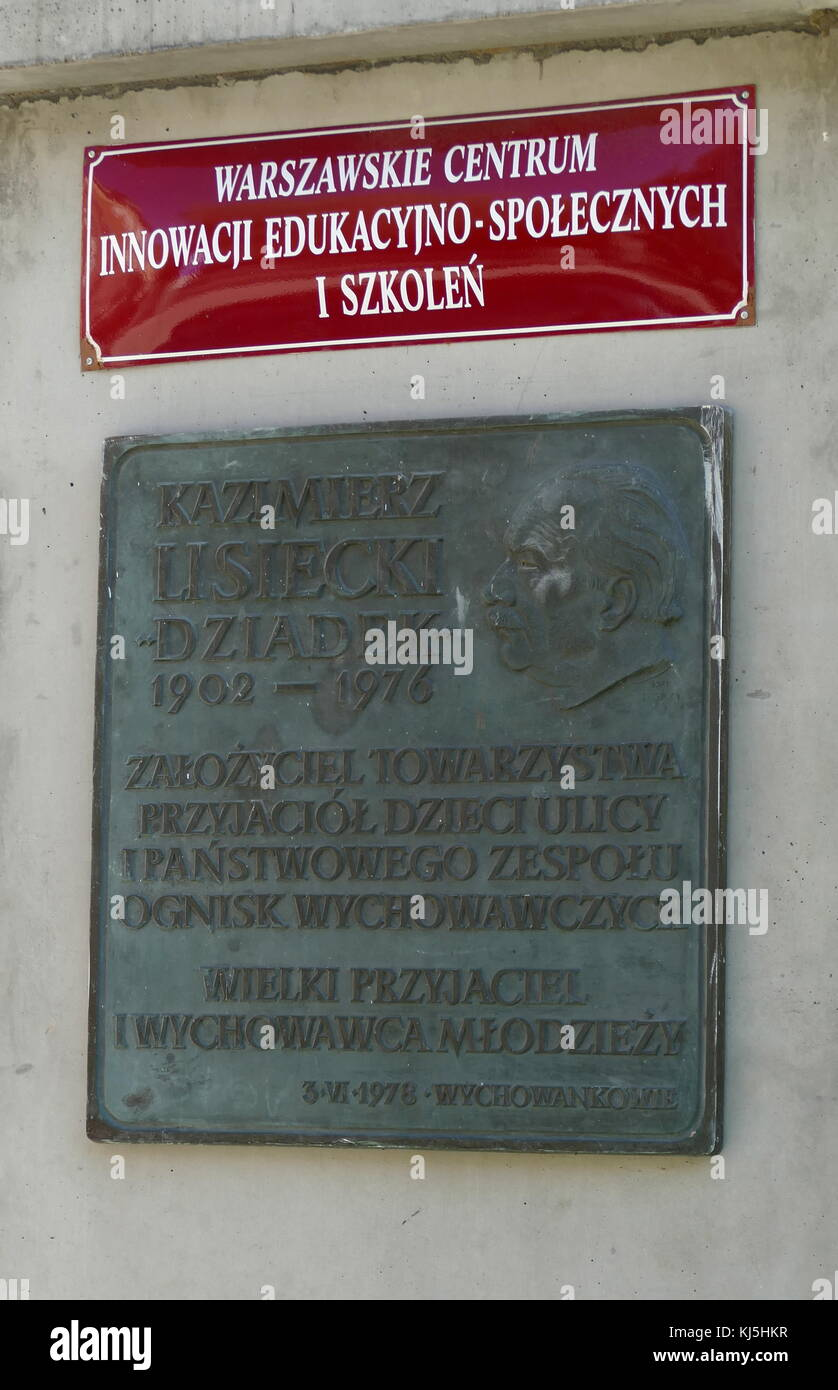 plaque commemorating Kazimierz Lisiecki in Prague Park, Warsaw, Poland. (born 9 February 1902, died December 8, - Stock Image