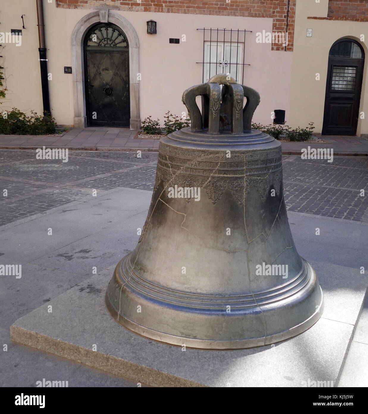 Bell in Kanonia Square, Warsaw Old Town, Poland. In the middle of the square is a church bell from 1644 (cast by - Stock Image
