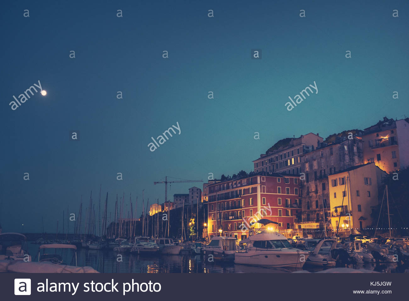 moon over port at night - Stock Image
