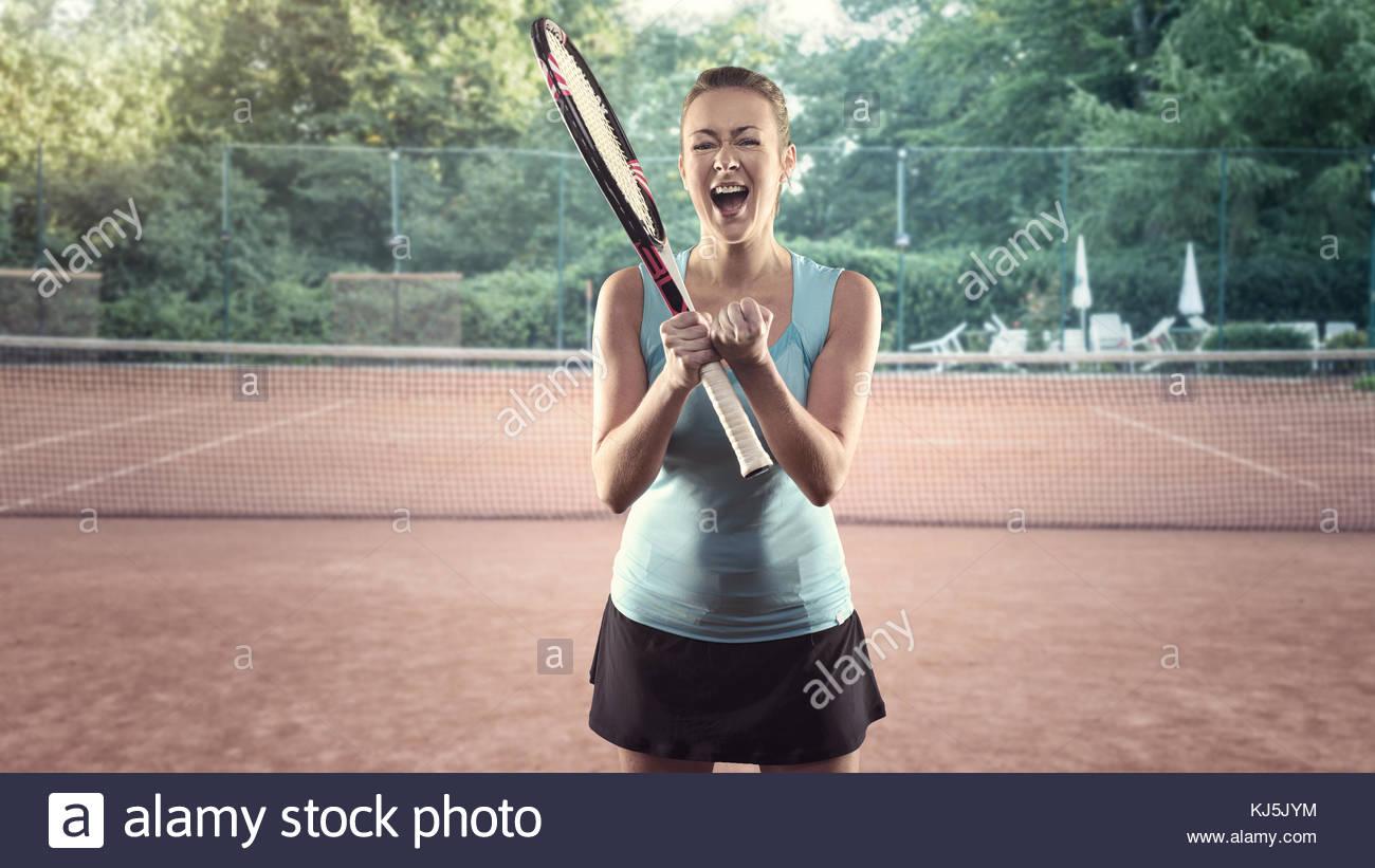Three Quarter Length Portrait of Athletic Blond Woman - Stock Image