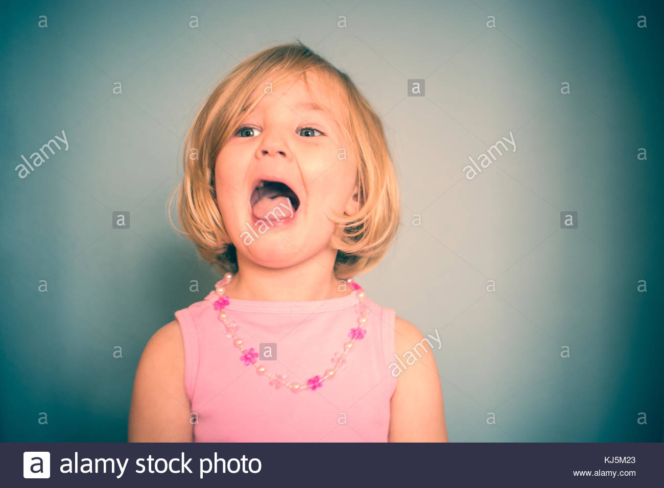 Little funny girl singing - Stock Image