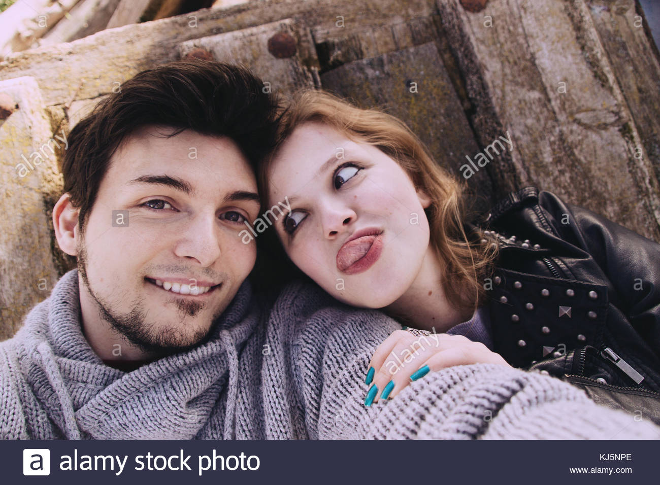 Lovely  happy young couple smile taking a selfie - Stock Image